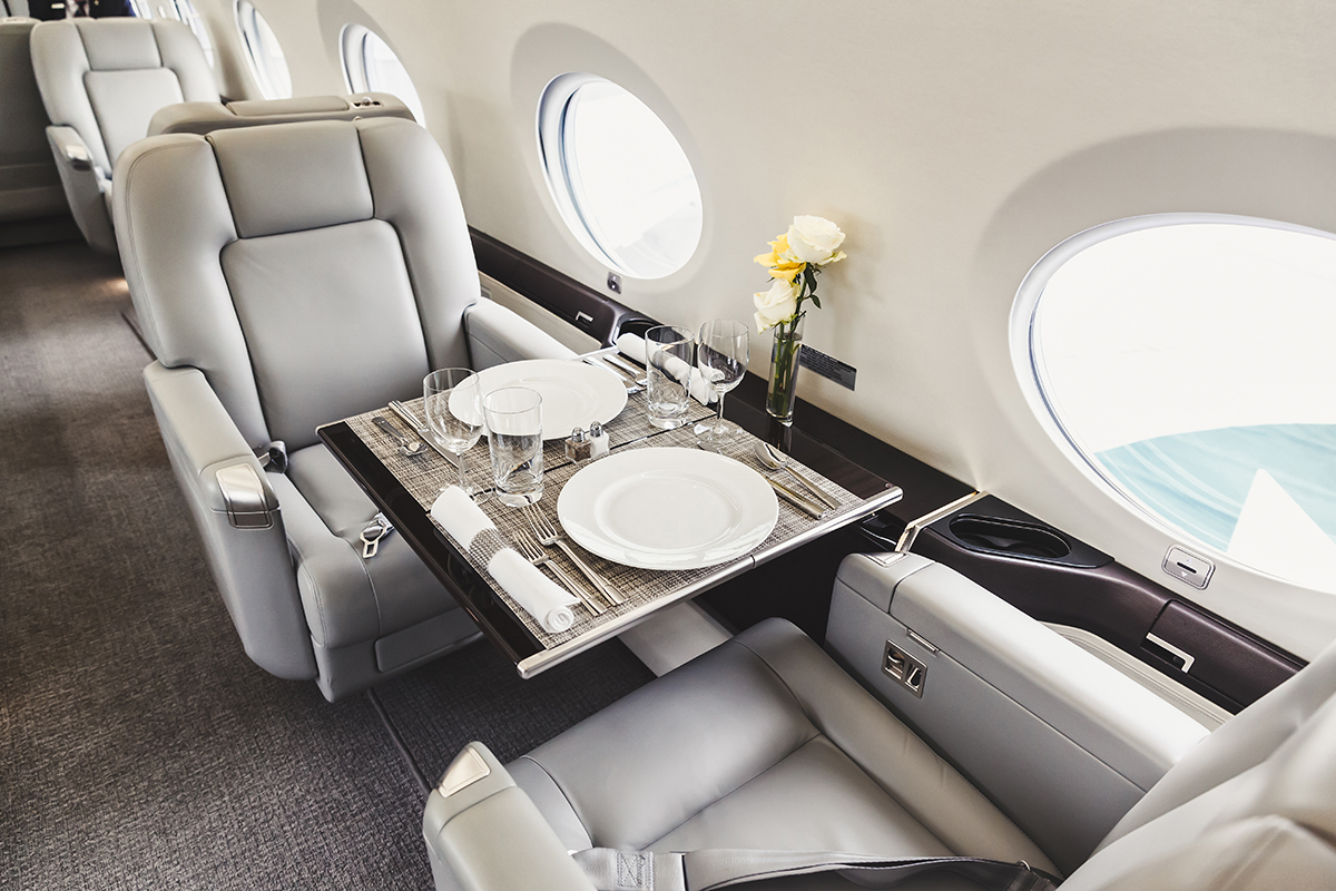 Table set for dinner on a private jet charter to Los Angeles
