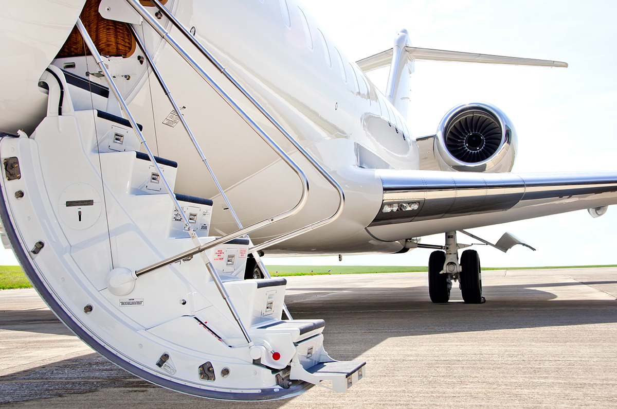 Private jet charter on a runway with stairs down