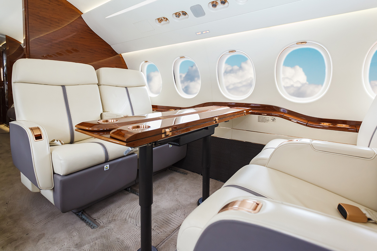 Seats and table on a private jet charter
