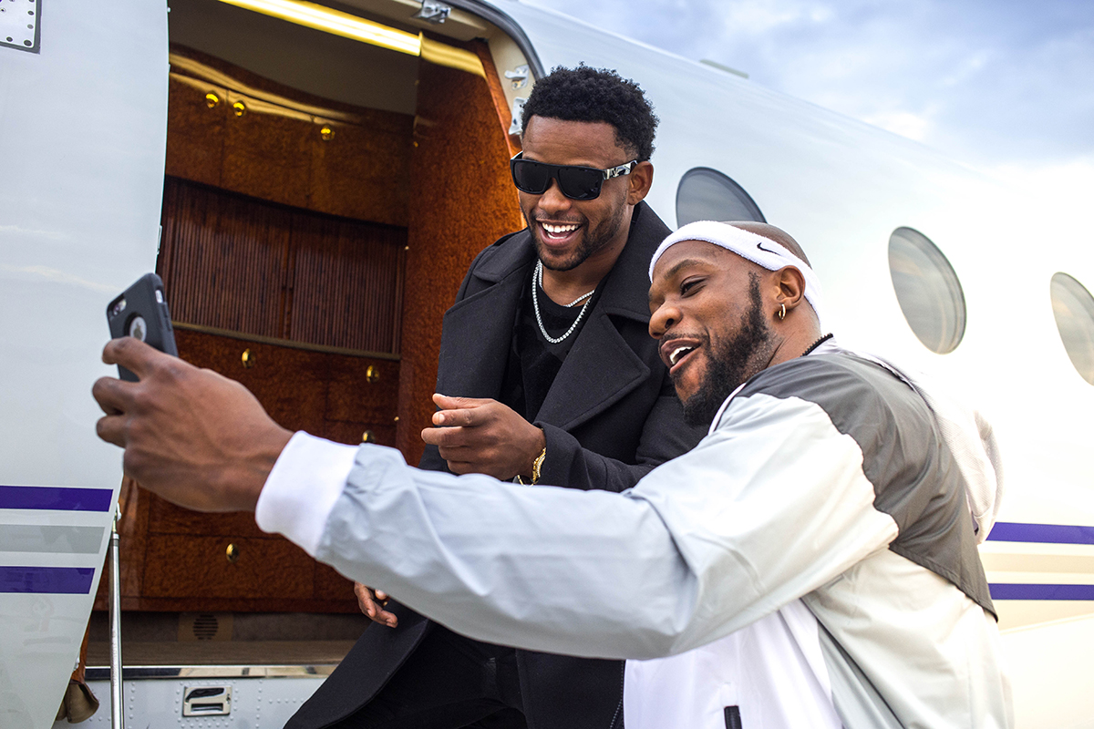 2 celebrities taking a photo on a private jet in Las Vegas