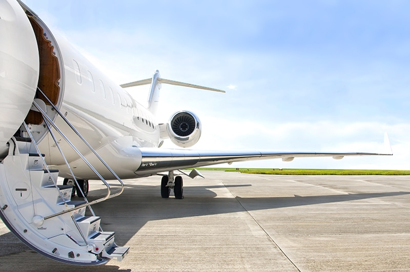 Private jet charter on a runway with it's steps down