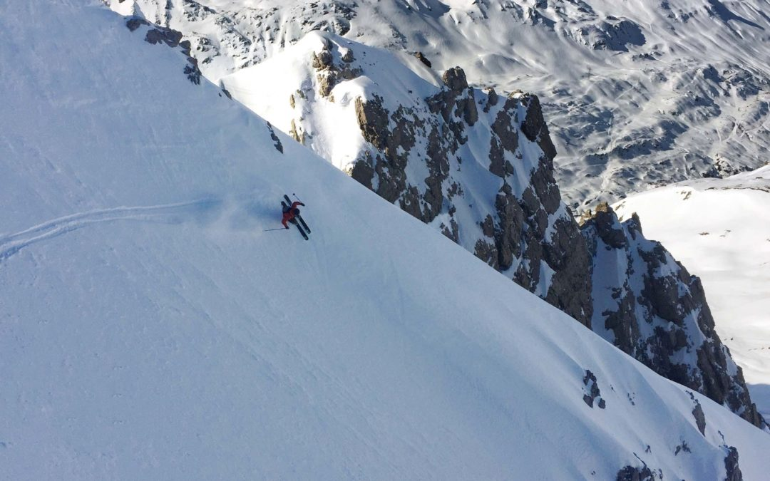 Man Skiing Down a Mountain after a jet charter to Vail