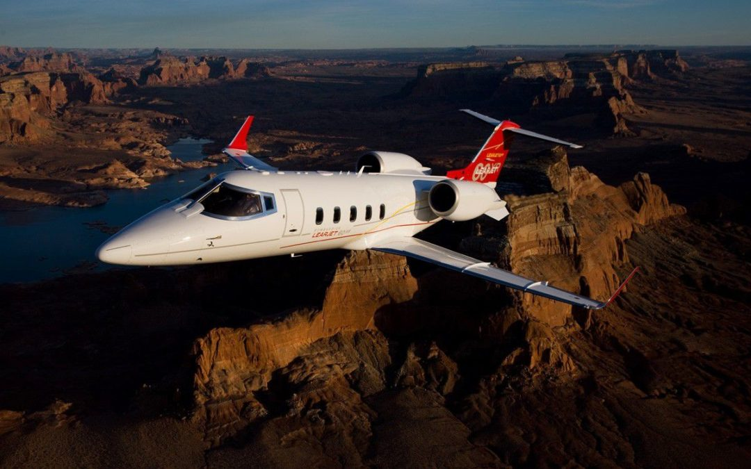 New private jet charter flying over dallas