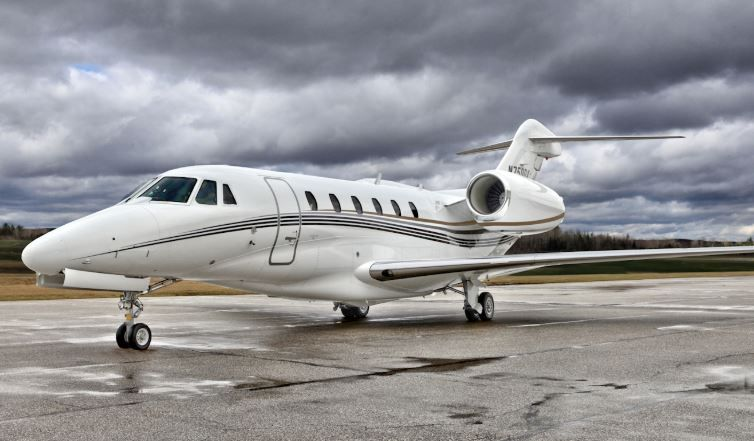 Green Private Jet Charters on a runway